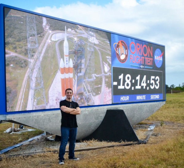 At the new KSC countdown clock prior to Orion's EFT-1 flight, Dec. 2014