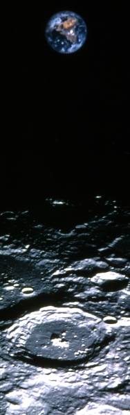 Earth above the north pole of the Moon from Clementine in 1994. The crater in the foreground is about 68 miles across. (USGS)