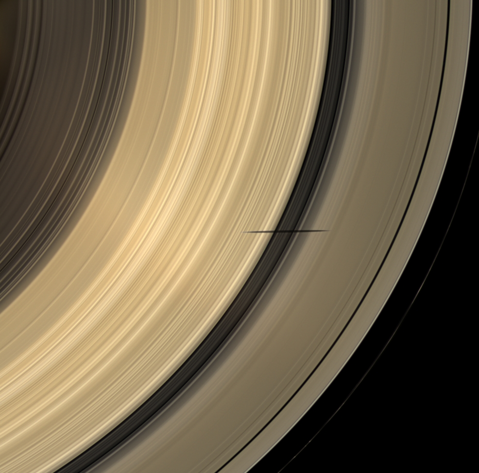Mimas' shadow darkens the rings