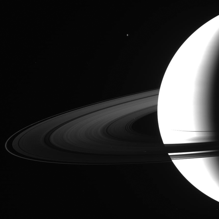 Cassini photographs Saturn and moon