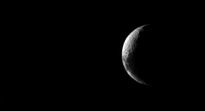 The sun shines on Iapetus' lighter surface