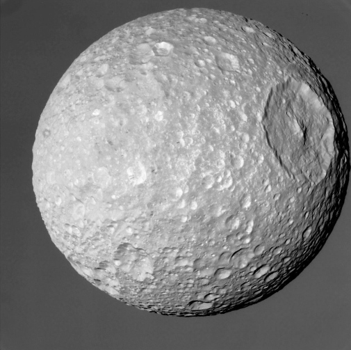 Image of Mimas and Herschel Crater from Feb. 2010. (NASA/JPL/SSI)