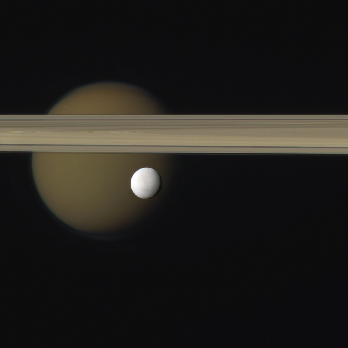 Pretty As A Picture Enceladus And Titan Lights In The Dark