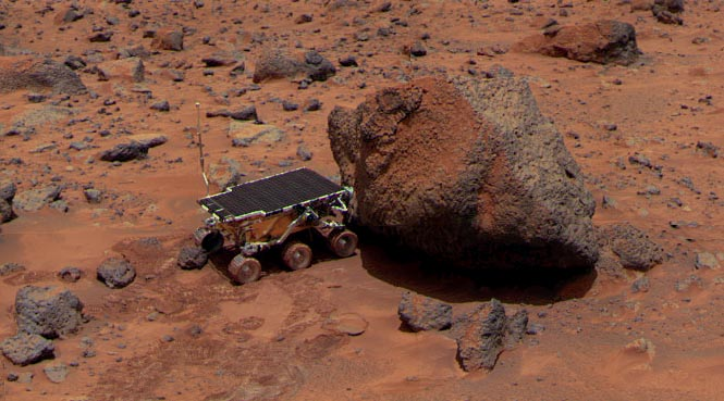 "Sojourner investigates a rock named ""Yogi Bear"" (NASA/JPL-Caltech)"