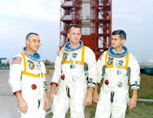 "Apollo 1 astronauts Virgil I. ""Gus"" Grissom, Edward H. White II and Roger B. Chaffee in front of Launch Complex 34 at Kennedy Space Center on January 17, 1967 (NASA/KSC)"