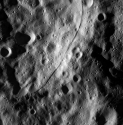 A long fracture in a crater wall on Rhea (2013-03-09)
