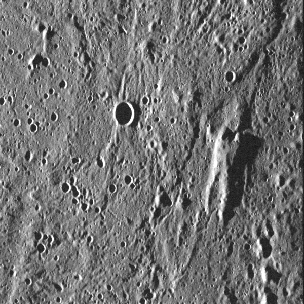 A curiously human shape rises from the surface of Mercury in this MESSENGER image