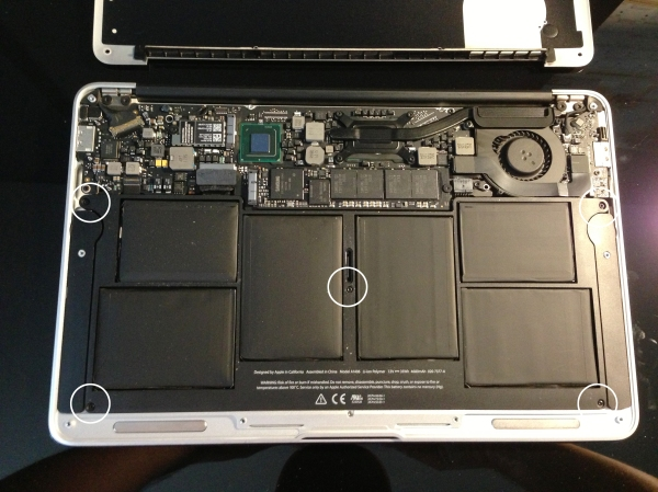 Most of the inside is taken up by the battery itself. Mid-2011 models have 5 screws - remove these.