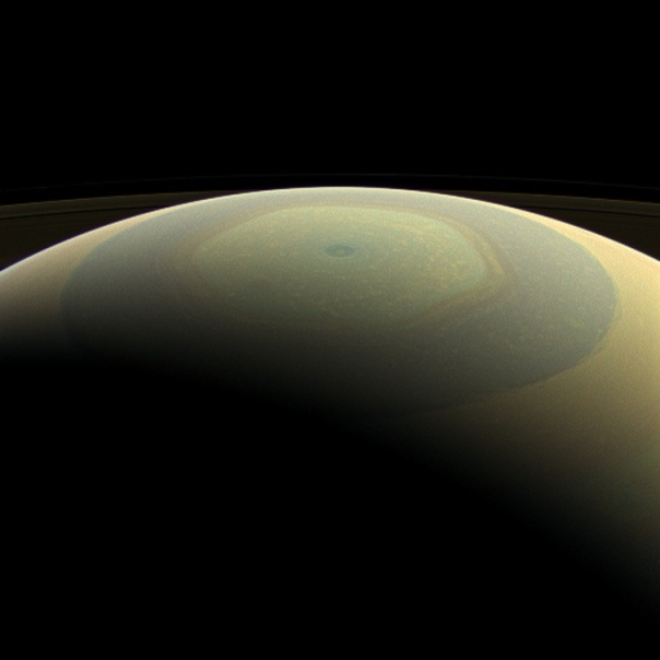 Saturn makes a beautifully-striped ornament in this natural-color image, showing its north polar hexagon jet stream and central vortex (Credit: NASA/JPL-Caltech/Space Science Institute)