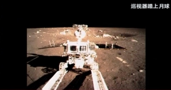 Screenshot of a CCTV video showing the Yutu rover rolling onto the lunar surface (CCTV)