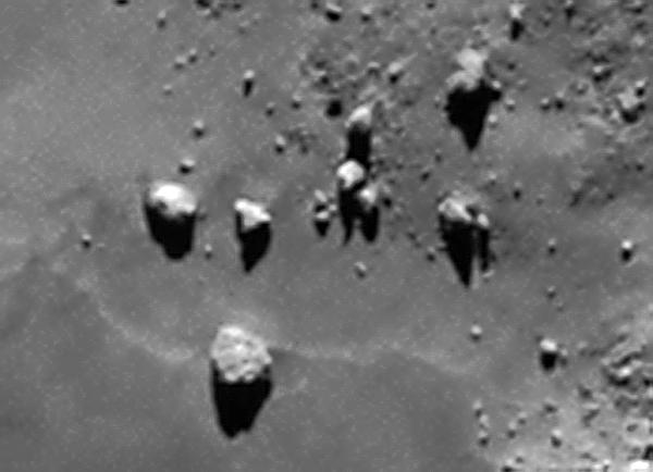 A close-up of boulders on 67P/C-G imaged by OSIRIS from 130 km. The largest one is about 38 meters (125 feet) wide. Credit: ESA/Rosetta/MPS for OSIRIS Team MPS/UPD/LAM/IAA/SSO/INTA/UPM/DASP/IDA. Edited by J. Major.