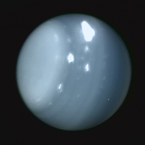 Infrared image of Uranus acquired from the Keck Observatory on Aug. 6 2014 (Imke de Pater (UC Berkeley)/Keck Observatory) Colored with Voyager true-color data.