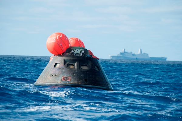 NASA's Orion spacecraft awaits the U.S. Navy's USS Anchorage for a ride home. (NASA)