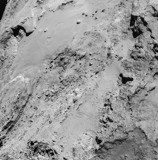 The surface of 67P/C-G imaged by Rosetta on Feb. 14, 2015 from about 8.9 km (Credits: ESA/Rosetta/NavCam – CC BY-SA IGO 3.0)