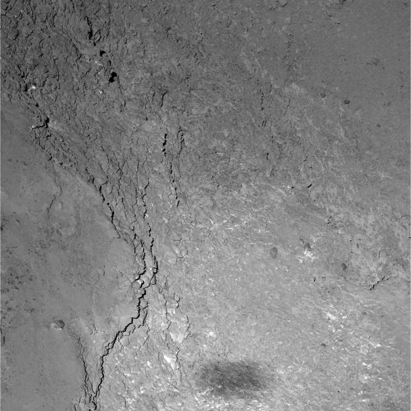 Close view of a 228 x 228 meter region on Comet 67P/C-G. Rosetta's shadow can be seen at the bottom. (ESA/Rosetta/MPS for OSIRIS Team MPS/UPD/LAM/IAA/SSO/INTA/UPM/DASP/IDA)