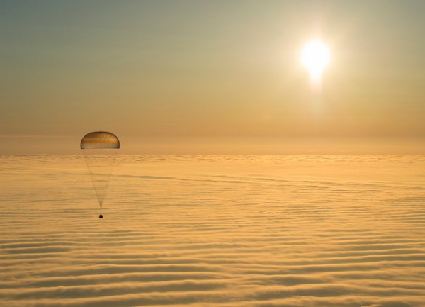 The Expedition 42 Soyuz capsule descending via parachute to land in Kazakhstan on March 12, 2015. (NASA/Bill Ingalls)