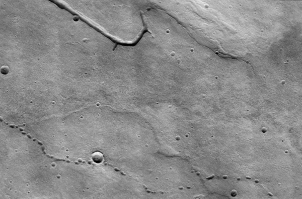 THEMIS image of collapse pits on Mars above potential lava tubes (NASA/JPL/ASU)