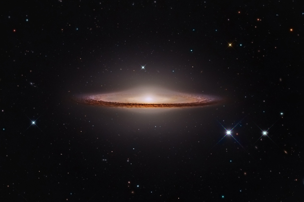 Image of M104 made from data acquired by Hubble, Subaru, and amateur telescopes. Flipped horizontally to match Cassini's view. (APOD Feb. 5, 2015.) Credit: NASA, ESO , NAOJ, Giovanni Paglioli - Processing: R. Colombari.