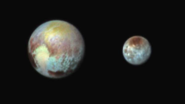 False-color image of Pluto and Charon highlights regional color variations on the two worlds (NASA/APL/SwRI)