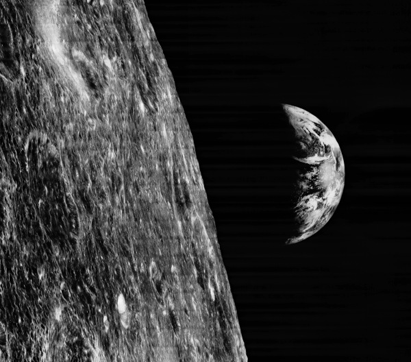 Earth was seen from the Moon for the first time by Lunar Orbiter I on August 23, 1966. (NASA/LPI/USGS)