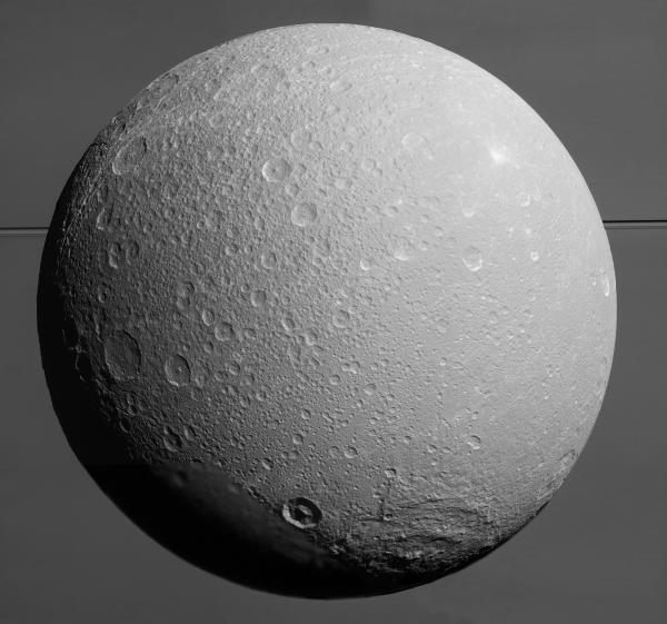Mosaic of Saturn's 700-mile-wide moon Dione made from nine images acquired on Aug. 17, 2015. Saturn itself covers the entire background. (NASA/JPL/SSI)
