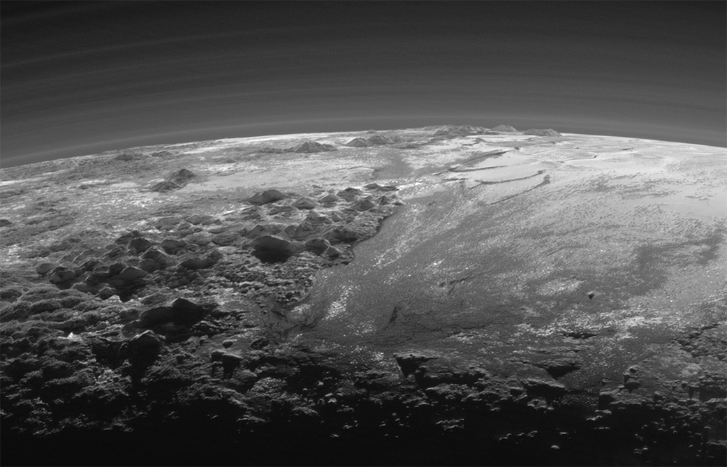 NASA just published one of the greatest space pictures ever taken. Sunset over the mountains of Pluto.