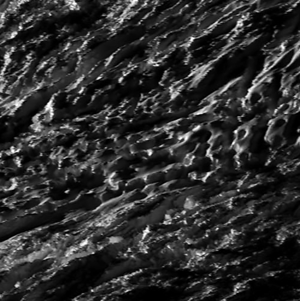 The clearest view thus far of Enceladus' surface from E-21, captured during closest approach. (Raw image has been upscaled and rotated.)