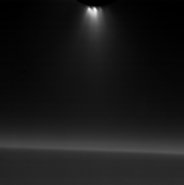 Narrow-angle image of Enceladus' backlit plumes shooting from its south pole. Saturn's nightside limb is in the background.
