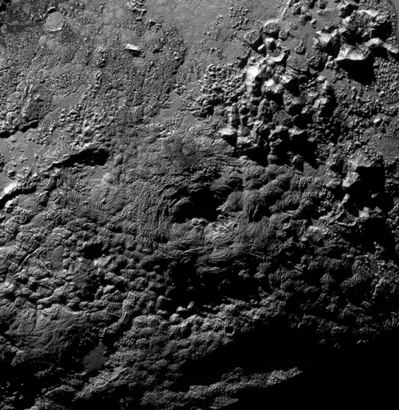 A hummocky feature on Pluto named Wright Mons may be a cryovolcano, 13,000 feet (4 km) high. (NASA/JHUAPL/SwRI)