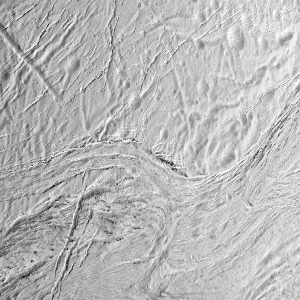 Frozen fractures: deep furrows in Enceladus' south polar region known as Samarkand Sulci (NASA/JPL/SSI)