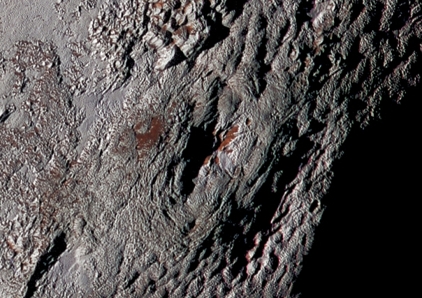 "New Horizons image of ""Wright Mons,"" a cryovolcano on Pluto (NASA/JHUAPL/SwRI)"