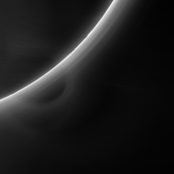 LORRI image of Pluto's backlit atmosphere taken as New Horizons was departing the planet; the circular artifact is lens glare but banding in the atmosphere as well as silhouettes of surface features are visible. (NASA/JHUAPL/SwRI)