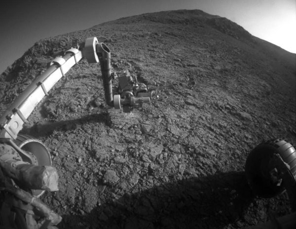 "A recent view of Opportunity's robotic arm extended to remove surface crust from a rock target called ""Private John Potts,"" named for a member of Lewis and Clark's expedition. (NASA/JPL-Caltech)"