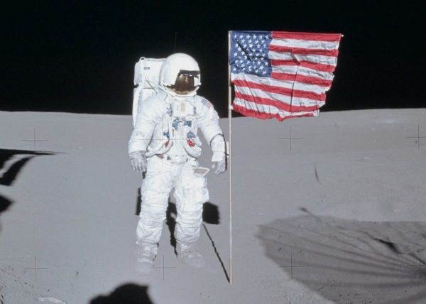 Edgar Mitchell poses next to the U.S. flag on the Moon during Apollo 14, Feb. 1971 (NASA)