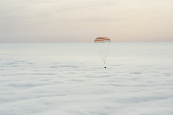 Retrieval helicopter view of the descending Expedition 46 Soyuz on March 1, 2016. Credit: NASA/Bill Ingalls