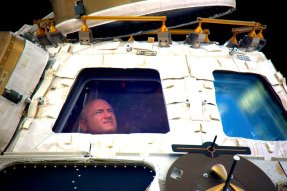 Photo of Scott Kelly inside the Cupola on the ISS (NASA)