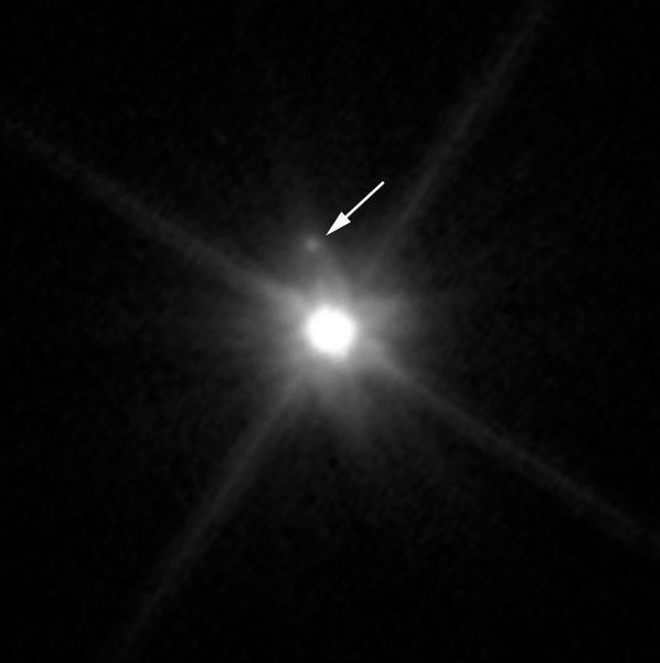 Hubble Telescope image showing the presence of a small moon orbiting the dwarf planet Makemake. Credit: NASA, ESA, A. Parker and M. Buie (Southwest Research Institute), W. Grundy (Lowell Observatory), and K. Noll (NASA GSFC).