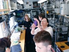 NASA Social attendees check out a modular NOAA lab aboard Atlantis