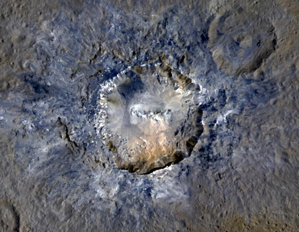 Enhanced-color view of Haulani Crater on Ceres. Credit: NASA/JPL-Caltech/UCLA/MPS/DLR/IDA