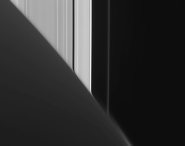 Saturn's atmosphere distorts the line of the rings beyond in this raw image from Cassini (NASA/JPL-Caltech/SSI)