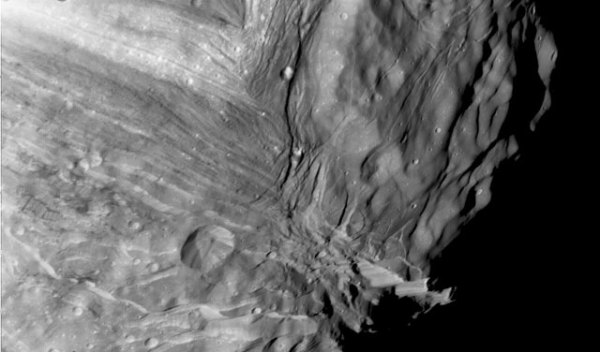 "The ""Frankenstein"" surface of Uranus' 310-mile-wide moon Miranda, including the 6-mile-high sheer cliff Verona Rupes (lower right.) Credit; NASA/JPL"