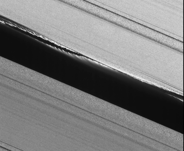 Cassini narrow-angle camera image of the Keeler Gap after Daphnis' passing. NASA/JPL/SSI (original here)
