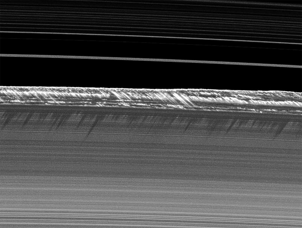 Icy particles along Saturn's B ring rise dramatically in mile-high spikes, seen by Cassini in August 2009. (NASA/JPL-Caltech/SSI)