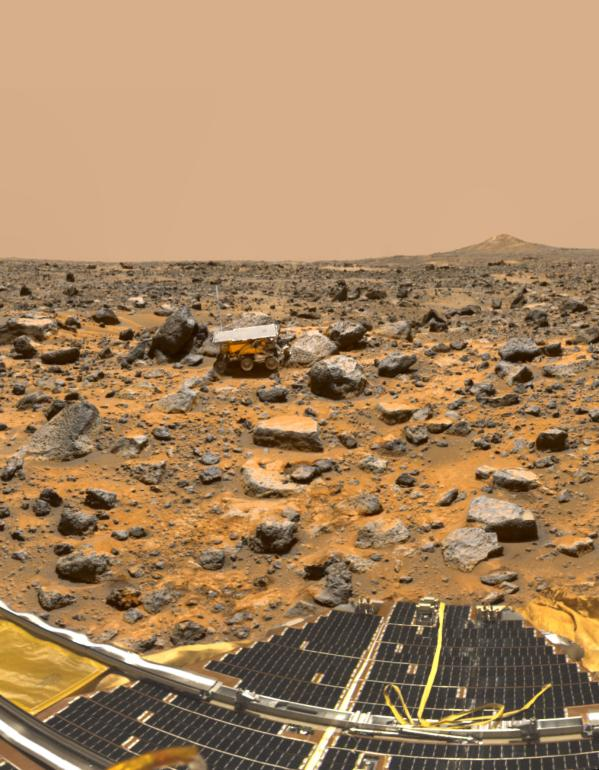 A true-color panorama of Pathfinder's Ares Vallis landing site captured from the Mars Pathfinder lander. The image shows the Pathfinder rover, Sojourner, snuggled against a rock nicknamed Moe. The south peak of two hills, known as Twin Peaks, can be seen on the horizon, about 1 kilometer away. (Credit: NASA/JPL)